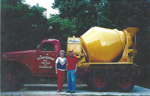 the Red-D-Mix Concrete founder and his wife with the first mixer