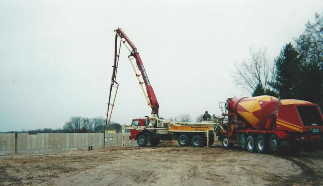 Red-D-Mix concrete pump truck and mixer on the job